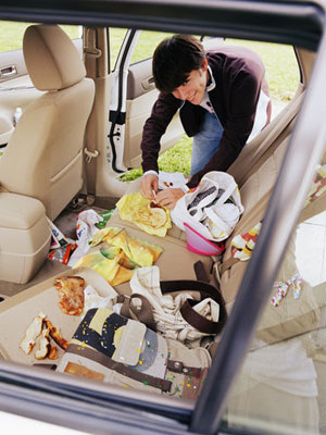 Another mum cleaning the car after a road trip.
